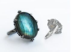 Gothic Gemstone Jewelry by Aranwen :: Pewter Ring with Labradorite  This is an impressive ring with a thin band and beautiful details around its bezel. The crown of the ring is elevated above the band so the light passes through the stone and highlights its details. A gorgeous Labradorite cabochon is set in this ring, with a colour range from brown to luminous green and aqua blue. This ring will make a statement with every move of your hand; always changing colours, never static or boring…