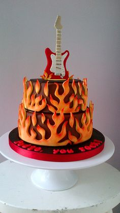 Electric Guitar Cake; looking more at the guitar than the fire; flames don't really go with baby shower theme LOL