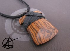 Toki pendant hand carved from professionally stabilized bocote wood