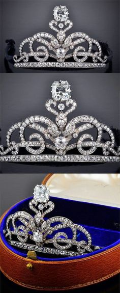 chrischelsea12548:  AN ANTIQUE DIAMOND TIARA Designed as intertwined scrolling lines set with old-cut diamonds, on a diamond-set line base, centering upon a cushion-shaped diamond under a foliate motif, surmounted by a cushion-shaped diamond, weighing 14.29 carats, to the detachable gold headband, covered with black velvet, mounted in silver and gold, circa 1900, in brown leather case. Formerly the property of Dame Miriam Rothschild DBE, FRS