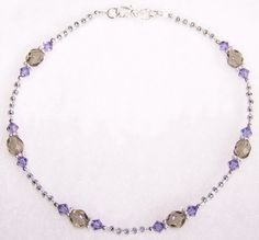 "Anklet - handmade beaded with    Swarovski ""Tanzanite"" crystals, Czech""Smokey Quartz"" fire-polished glass beads, glass seed beads, sterling silver bali spacers, sterling silver beads and findings, and finished with a sterling silver ""S"" clasp."