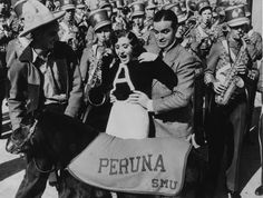 Bob Hope and Gracie Allen meet SMU mascot Peruna II at the 1935 Rose Bowl.
