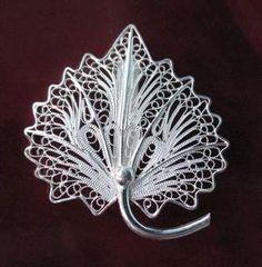 http://i00.i.aliimg.com/photo/103360084/Flower_filigree_jewelry.jpg