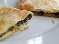 Toddler meal idea: quesadillas from sauteed greens and onions with a little cheese. Food that's fun and interesting for toddler hands. :)