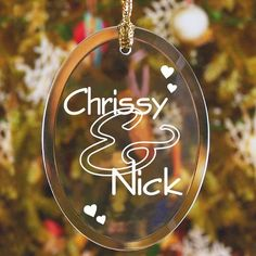 Couples Engraved Oval Glass #Christmas Tree Ornaments. Perfect for the couple who is in Love! Celebrate your unity & commitment to each other by displaying your names intertwined in Love with our Personalize Couple Ornament. Each personalized love ornament is a beautiful addition on the Christmas tree or simply hanging in the kitchen window reflecting the morning sunrise. Our Personalized Glass Ornaments also makes a wonderful Valentine's Day gift. Our Personalized