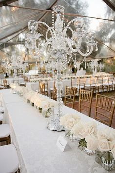 Candelabras + Bunches of Roses Under a Clear Tent - Elegant!   Photography: Red Fly Studio