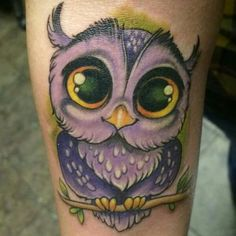 Purple owl tattoo