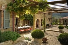 Eat, with friends, on this luxury patio in Italy