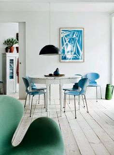A Vesterbro home, Arne Jacobsen blue Ant Chair, old white round table. Beautiful white scandinavian interior.
