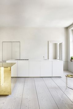 Stockholm home white and yellow gold kitchen A very minimalistic and trendy home in Stockholm