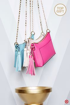 Give the gift of fresh, vibrant color and chic style to your favorite trendsetter this Christmas. Completely on-trend and adorable, these purses feature a delicate gold metallic chain strap and fun tassel detailing to up the style ante. Available in assorted colors, you can easily gift one to all the girls on your list—like your mom, sister, friend, yourself… This gift is totally in the bag.