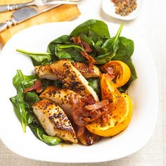 Pepper-seasoned turkey breast, deli ham, and juicy oranges top fresh wilted spinach. Cooking juices make a tasty dressing.