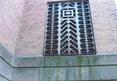 A beautiful old metal grille on the side of Washington Elementary school in Rockford Illinois.