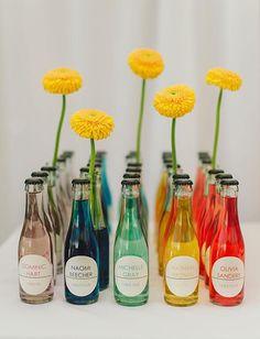 Soda bottle escort cards with flowers! | Brides.com