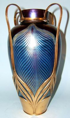A stunning Loetz and Osiris art nouveau vase c1900. Peacock feather decoration in petrol blue on a purple iridescent ground. by jessie