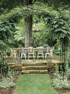 To make an outdoor dining area, use stacked stone for an elegant look that also creates a level surface for tables, chairs, and a grill.