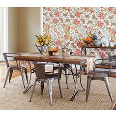 love these metal dining chairs paired with a wood table