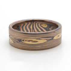 Rustic Wood Grain Mokume Gane wedding band in 14k Yellow Gold, 14k Red Gold, and Sterling Silver with Oxidized Finish