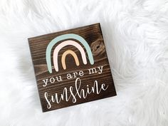 You Are My Sunshine Sign, You Are My Sunshine Sign, Mother's Day Sign, Mother's Day Decor, Mother's Day Gift, Gift for Mom, Gift for Her A beautiful way to let somebody know that you love them oodles and oodles! D E T A I L S ⋒ Freestanding - base is 2 thick and is perfect for table or desk decor! ⋒ Measures 5.5 x 5.5 x 2 of solid wood ⋒ Completed in your choice of stain colour (examples is shown in dark brown) ⋒ Painted with Mothers Day Signs, Mothers Day Decor, Mother Day Gifts, Gifts For Family, Gifts For Friends, Gifts For Mom, Brown And Grey, Dark Brown, Teacher Door Signs