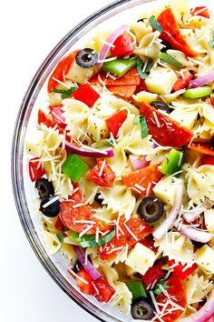 This Pizza Pasta Salad recipe is quick and easy to make, it's tossed with a…