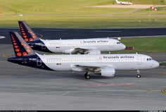 Brussels Airlines Airbus A320-214 (foreground) and Airbus A319-111 (background)