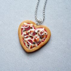 This Valentine's Day, say it with pizza.  Pizza Heart Pendant Necklace by SweetStella #pizza #polymerclay #sweetstelladesigns