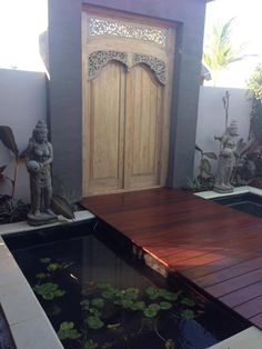 Balinese fish ponds inspired by our many stays at the Padma hotel in Bali.  Garden Designer Melisa Dixon