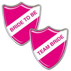 A Pink bride to be badge with accompanying team bride badges.