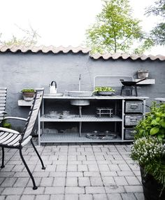 An outdoor kitchen can be an addition to your home and backyard that can completely change your style of living and entertaining. Earlier, barbecues temporarily set up, formed the extent of culinary attempts, but now cooking outdoors has become an. Outdoor Sinks, Outdoor Rooms, Outdoor Dining, Outdoor Gardens, Outdoor Decor, Outdoor Kitchens, Pergola, Summer Kitchen, Outdoor Kitchen Design