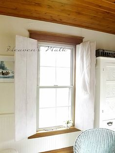 To keep things from looking too sweet, Laurie emphasizes charming farm house elements with rustic DIY projects like these wooden shutter