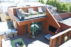 Rooftop deck with outdoor #kitchen and an open space to enjoy the sun. Check more at www.rhodeislandhomes.com