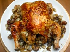Roasted chicken with pearl onions and grapes and a port sauce. Maybe do grapes instead of mushrooms? Everything is roasted in one pan - but the bird is not technically stuffed.