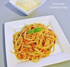 Best Ever Spaghetti with Tomato and Basil Recipe - Town & Country Living