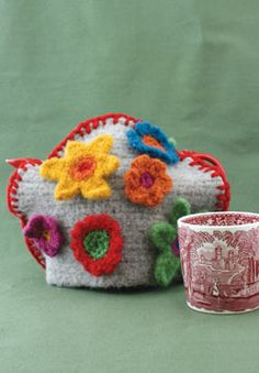The base of this charming tea cozy is made of easy single crochets. When felted and adorned with customized flowers, it becomes the perfect gift for your favorite green-thumbed gardener!