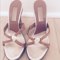 Michael Kors sandals sz 6 Gorgeous gold and tan Michael Kors sandals. Perfect for summer. Tan braided front with gold ring. Sz 6 and 4 in heels. Gently worn but still in good condition and priced accordingly. Thanks for looking! Michael Kors Shoes