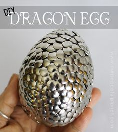 How to make a dragon egg using foam egg and thumb tacks.  So cute and so clever!