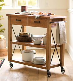 Rolling Wood Kitchen Cart | Kitchen Furniture - The heavy iron hardware and wheels create a vintage feel that will enhance any kitchen. Two drawers and two roomy shelves, all with a fine distressed finish, combine utility with aesthetic appeal to make this cart a must-have for your kitchen.