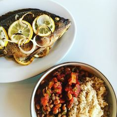 OMG! I just smashed this meal. Baked Whole Tilapia jerked and stuffed with onions and lemon. I also made black eye peas that's been in the crockpot since this morning and some @thrivemkt sprouted brown rice. #seafoodie