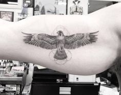 Fine line style eagle tattoo on the right inner arm. Tattoo artist: Dr. Woo