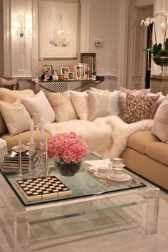 Chic living room- I would choose a different coffee table.  But, that couch looks like a cuddle monster couch!