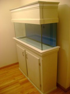 AQUARIUM STANDS AND CANOPIES