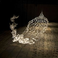 Isa Barbier, french artist feathers installation