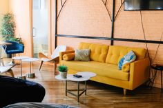 Sunbaked interior with yellow sofa and living coral walls Room Colors, Decor, Living Room Colors, Living Room Pictures, Furniture, Room Color Combination, Home, Living Room Decor Modern, Living Room Color