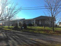 Room to Run! 3/3 on 2 fenced acres. Huge work garage, work shop, 2 kitchens, sunroom. $155,000 >>Heritage Real Estate Co.