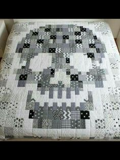 Black, white, and grey fabric make a perfect monochromatic quilt.. Skull motif...