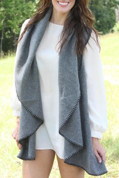 This soft vest features bold stitching around the hem. It is perfect for the fall months, not too heavy but will keep you warm! Pair this with jeans or a dress!   Sienna Stitched Vest  by Caroline Hill. Clothing - Jackets, Coats & Blazers - Vests West Virginia