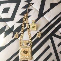 N1 Rich Paris perfume bottle jewelry set N1 Rich Paris perfume bottle necklace with gold chain and perfume bottle  ring with perfume bottle matching earrings Worn Not authentic Jewelry