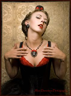 Pinup model..Burlesque theme..Miss Susan. Hair/mua Heather Pace. Jewelry by Lizzy D Creations. Photographer Jillian Danielson