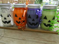 4-16-oz pumpkin face candle jars...listed on ebay