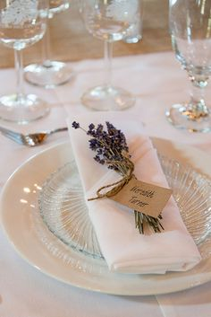 lavender wedding decor ideas table setting with white dishes with sprig of lavender svetlana photography